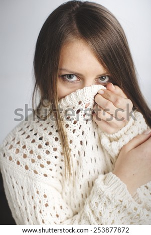 Beauty woman face portrait warmly clothed  - stock photo