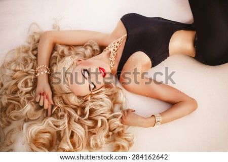 Beauty woman fashion model jewelry and makeup retro style female Vogue style sexy girl blonde. Gorgeous lady luxury life, beautiful woman sapphires and diamonds jewelery Fashion indoor portrait blond  - stock photo