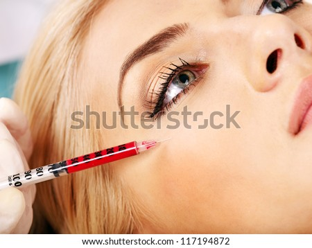 Beauty woman giving botox injections. - stock photo