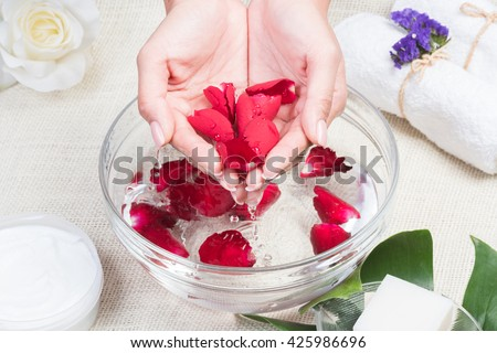 beauty woman hands with a bowl of aroma spa water on a table,Spa relaxation,Spa treatment. - stock photo