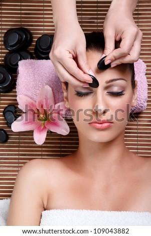 beauty woman having cosmetic massage,facial treatment, close up - stock photo