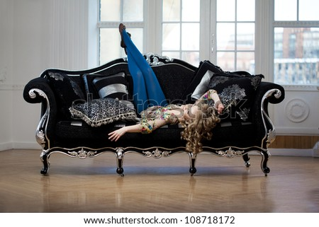 Beauty woman in luxurious sofa