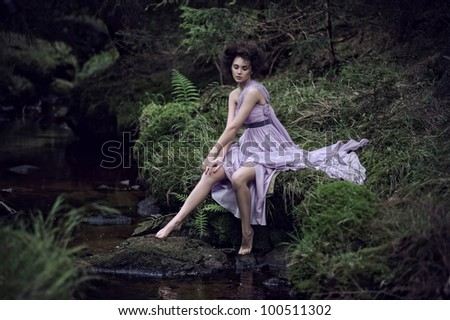 Beauty woman in nature scenery - stock photo