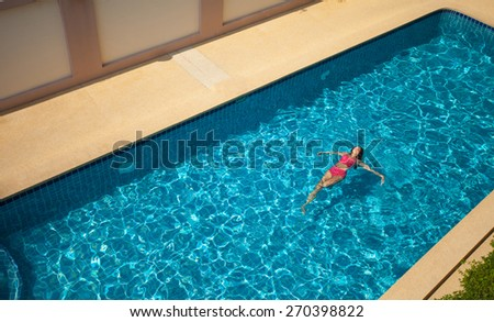 Beauty Woman In Red Swimming Suit Swimming and Relaxing In Big Blue 