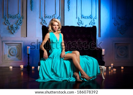 Beauty woman like a princess in the palace. Luxurious rich fashion stylish girl in a long evening dress.  - stock photo
