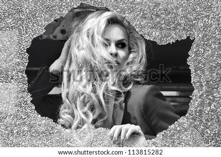 Beauty woman looks out the window - stock photo