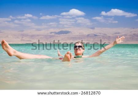 Beauty Woman Lying On Water. Dead Sea. Israel - stock photo