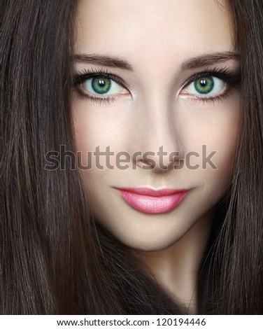 Beauty woman makeup face with green eyes and pink lips looking calm. Closeup fashion portrait - stock photo