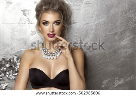 Beauty woman over silver background