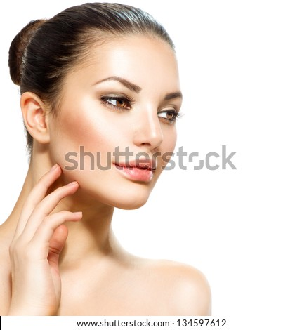 Beauty Woman Portrait. Beautiful Young Woman isolated on a White Background. Touching Her Face. Fresh Clean Skin. - stock photo