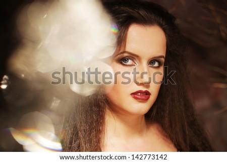 Beauty Woman Portrait.Curly Hair.Brunette Girl. Beautiful Girl's Face closeup - stock photo