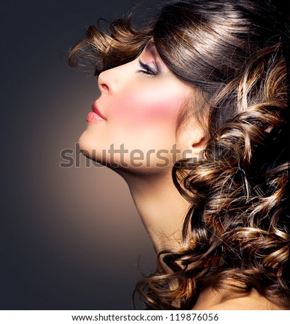 Beauty Woman Portrait.Curly Hair.Brunette Girl. Hairstyle. Beautiful Girl's Face closeup - stock photo