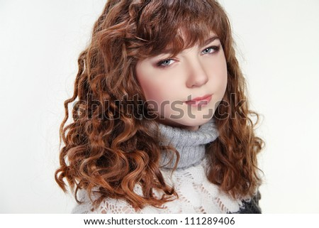 Beauty woman portrait of teen girl with long curly brown hair and clean skin - stock photo