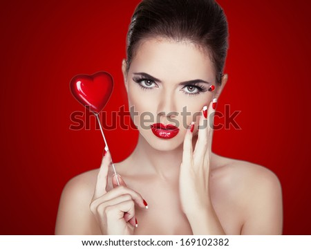 Beauty Woman Portrait. Professional Makeup for Brunette with Red Lipstick.  Beautiful Fashion Model Girl. Perfect Skin. Make up. Isolated on Red Background. - stock photo
