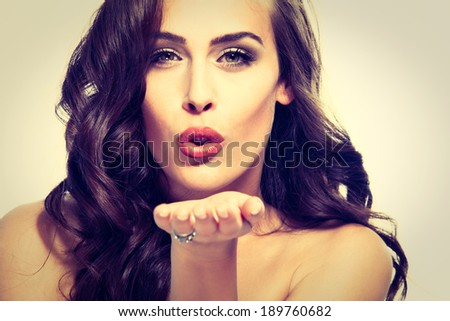 beauty woman portrait send a kiss studio shot  - stock photo