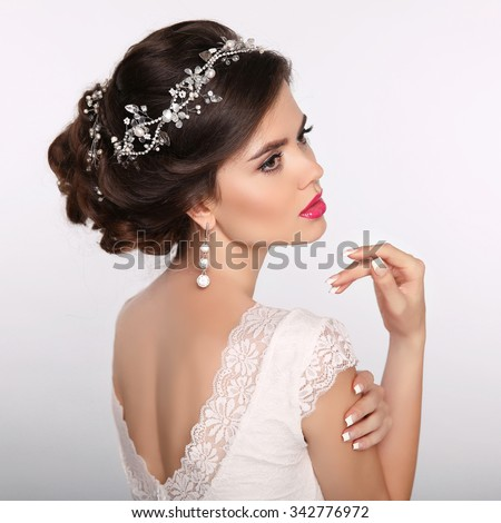 Beauty woman portrait. Wedding Hairstyle. Beautiful fashion bride girl model. Luxury jewelry.  Manicured nails. Attractive young woman with hair style. - stock photo