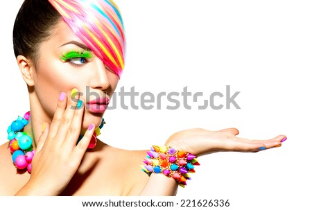 Beauty Woman Portrait with Colorful Makeup, Hair, Nail polish and Accessories. Colourful Studio Shot of Funny Model Girl. Vivid Colors. Manicure and Hairstyle. Rainbow Colors  - stock photo