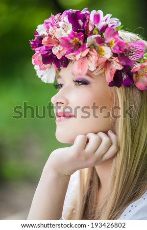 beauty woman portrait with wreath from flowers on head