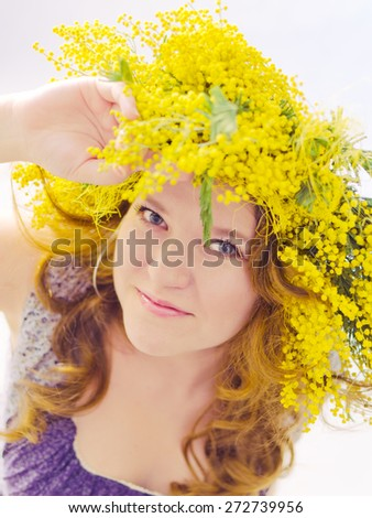 beauty woman portrait with wreath from flowers on head over white background