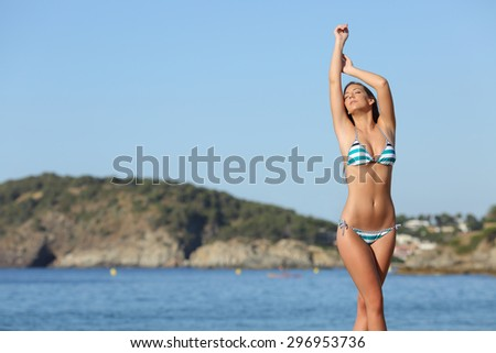 Beauty woman posing and showing her laser hair removal legs and armpit - stock photo