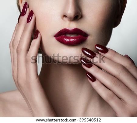 Beauty Woman. Professional Makeup. Burgundy red Lipstick. Beauty Red Lip. Perfect manicure. - stock photo