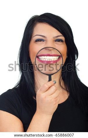 Beauty woman showing with a magnifying glass her white toothy smile isolated on white background - stock photo