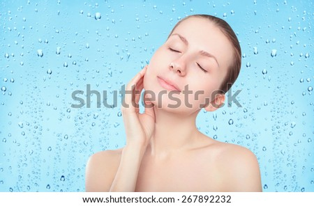 Beauty woman, skin care and freshness background with splash water drops, female portrait enjoying clean skin - stock photo