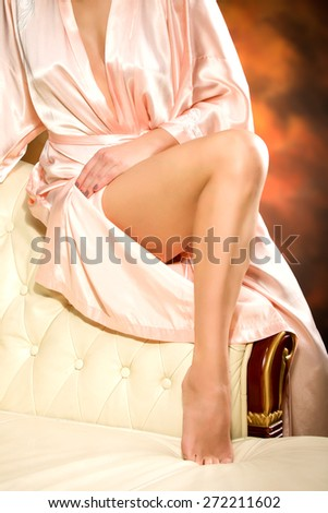 Beauty woman slim legs at colored  background - stock photo