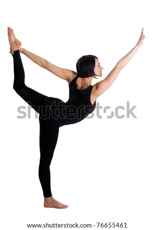 Beauty woman stand in yoga asana - Dancer Pose - stock photo