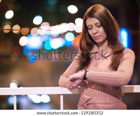 beauty woman wath to clock wait date - stock photo