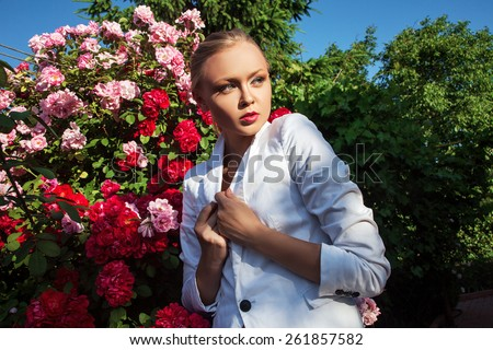 Beauty woman with bunch flowers. Professional Makeup and hairstyle