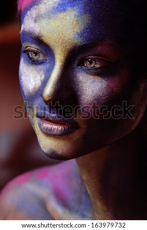 beauty woman with creative make up like Holy celebration in India