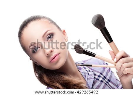 Beauty woman with Makeup Brushes. Natural Make-up for Brunette girl  Beautiful Face. Makeover. Perfect Skin. Applying Makeup - stock photo