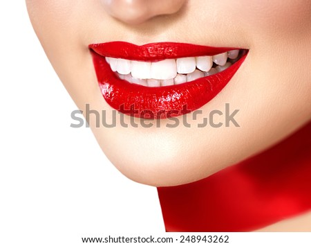 Beauty woman with perfect smile. Beautiful Model Girl with red lips and red silk scarf isolated on white background. Teeth whitening. Holiday make up, perfect skin - stock photo