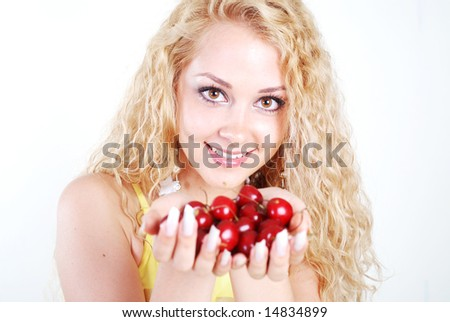 Beauty woman with red cherry in hands at white background