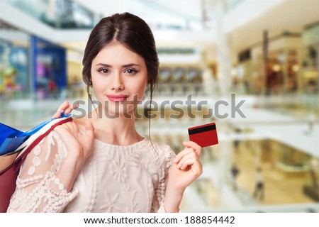 Beauty Woman with Shopping Bags in Shopping Mall. - stock photo