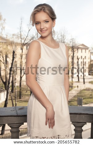 Beauty woman with wedding hairstyle and makeup. Bride fashion. Jewelry and Beauty. Woman in white dress,perfect skin, blond hair. Girl with stylish haircut. - stock photo