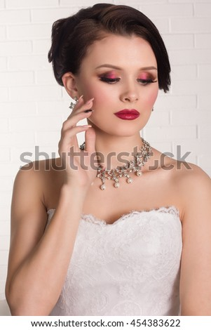 Beauty woman with wedding hairstyle. Bride fashion. Jewelry and Beauty. Girl with stylish haircut.