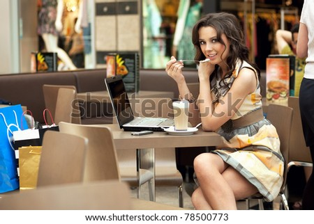 Beauty woman working on her laptop - stock photo