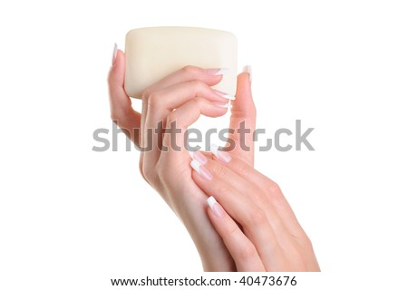 Beauty women hand holding the white soap - over white background - stock photo