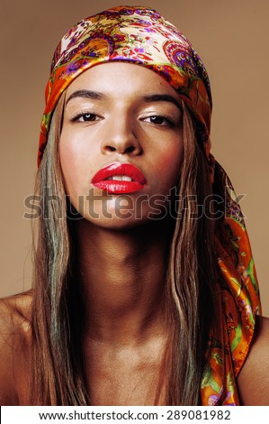 beauty young afro american woman in shawl on head smiling close up swag - stock photo