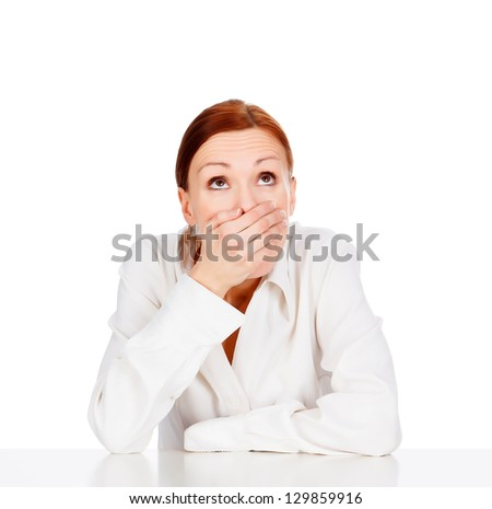 Beauty young business woman covering mouth, white background - stock photo