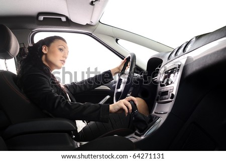beauty young businesswoman drive the car. you can set any background in place of white windows - stock photo
