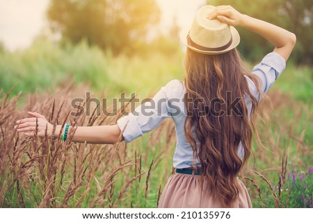 Beauty young girl outdoors enjoying nature - stock photo