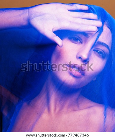 beauty young islamic woman under veil, blue hijab on face close up