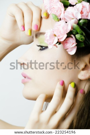 Beauty young real woman with flowers and make up closeup - stock photo