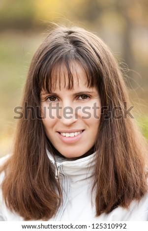 Beauty young smiling caucasian woman walking outdoor - stock photo