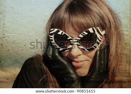 beauty young woman in funny sunglasses, vintage pattern - stock photo