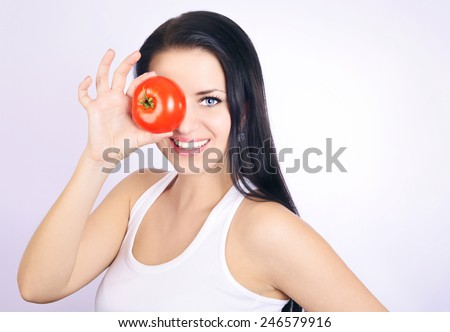 beauty young woman in white shirt with tomato, woman holding ripe tomato, juiced red tomato, white background - stock photo