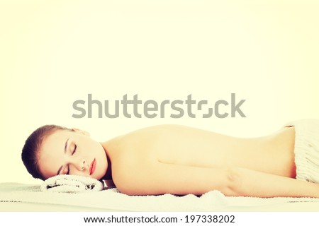 Beauty young woman relaxing in spa. - stock photo